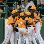 Jackie Robinson West All-Stars return to Chicago from Little League World ...