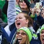 Despite misgivings, more Seattle women embracing the NFL