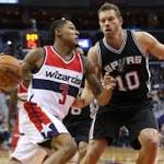 Wizards, with little in reserve, can't keep up with visiting Spurs