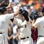 MLB Wrap: Grand slams carry Giants to win