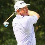 Westwood, McDowell share early lead in Malaysia